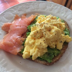 scrambled eggs with smoked salmon and avocado on toast